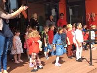 Children and staff celebrate at nursery opening