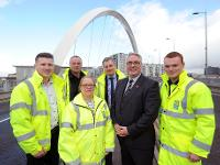 Councillor Frank McAveety meeting with staff from the roads team