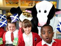 Pupils with cow mascot